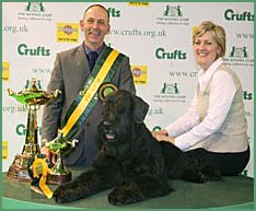 The Cullens with Crufts Supreme Champion Philip